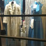 Image of Midland Care Findables winter window with a fur coat and light blue dress
