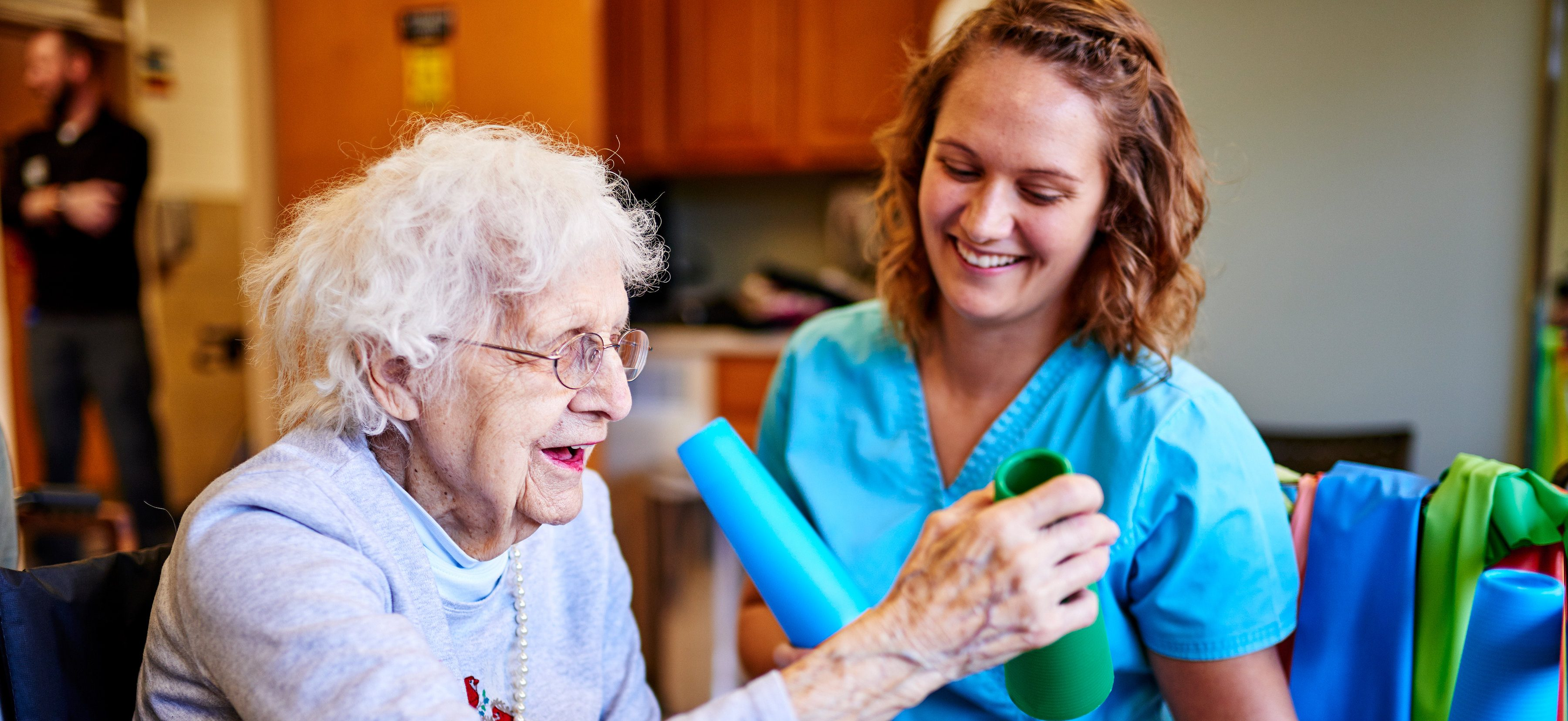 Photo of a Midland Care Physical Therapy Assistant working with a PACE participant