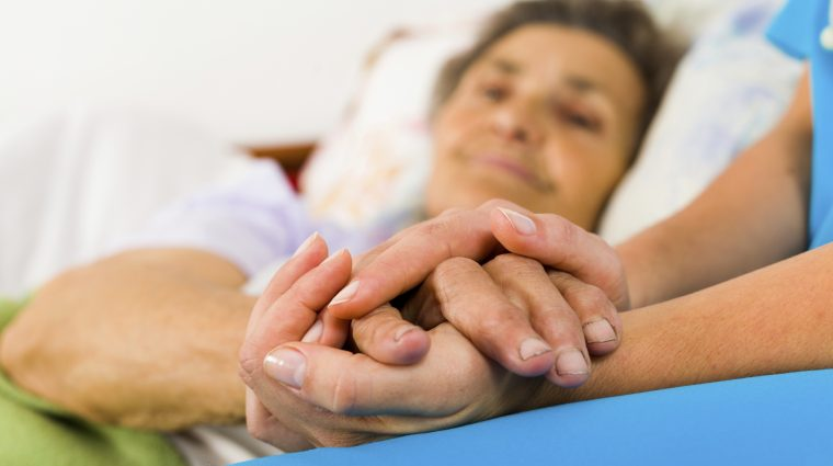 Image of a Caring Nurse Holding Hands