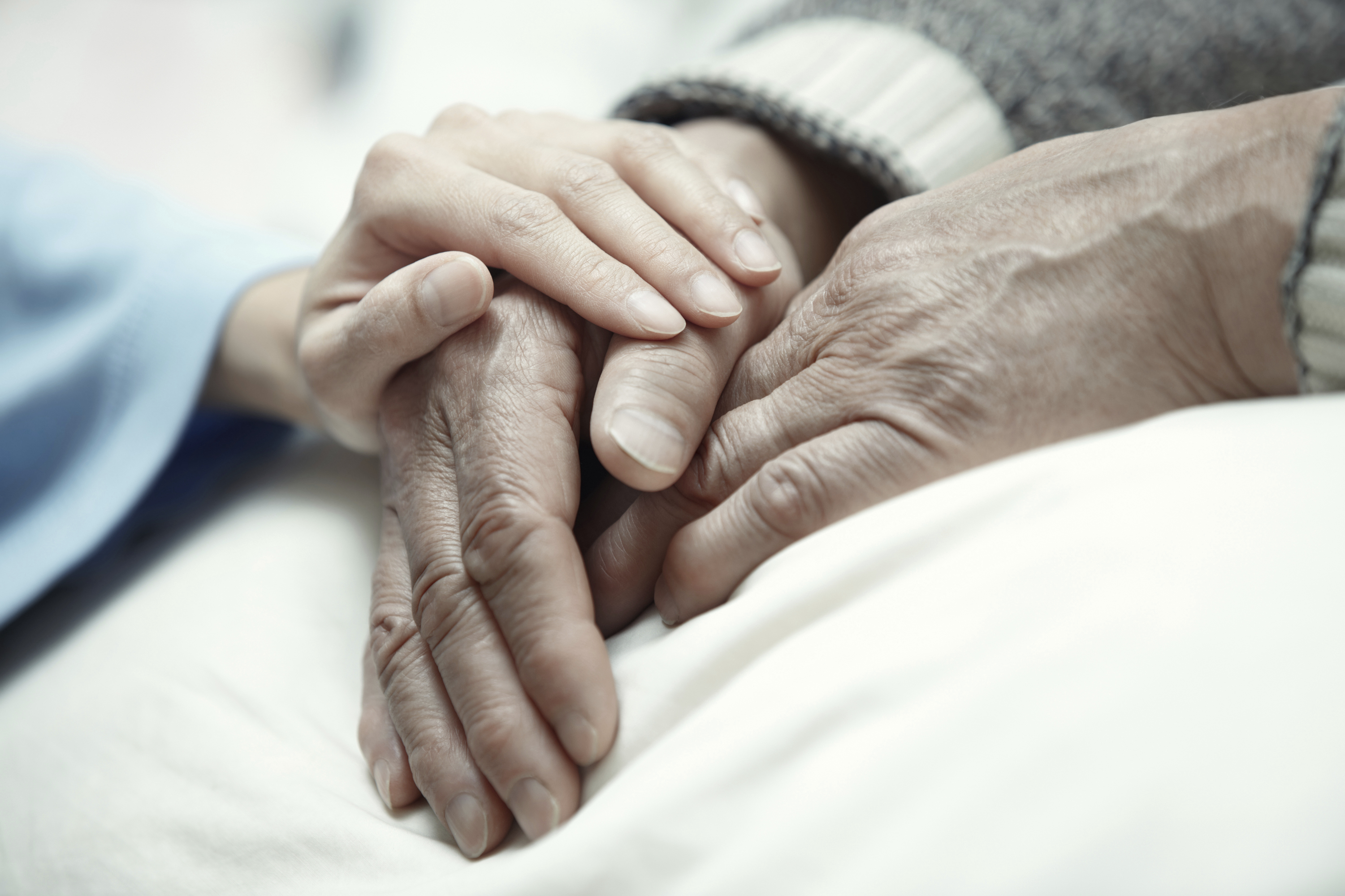 Image of hands, hospice care